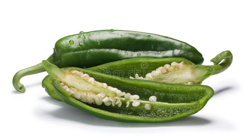 Gröna Anaheim chilies, banor arkivbild