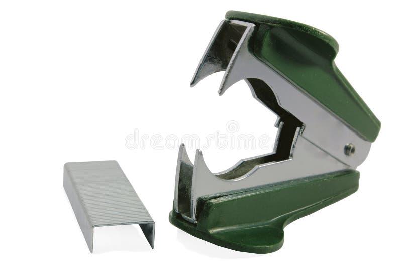 gröna borttagningsmedelhäftklammerhäftklamrar arkivbild