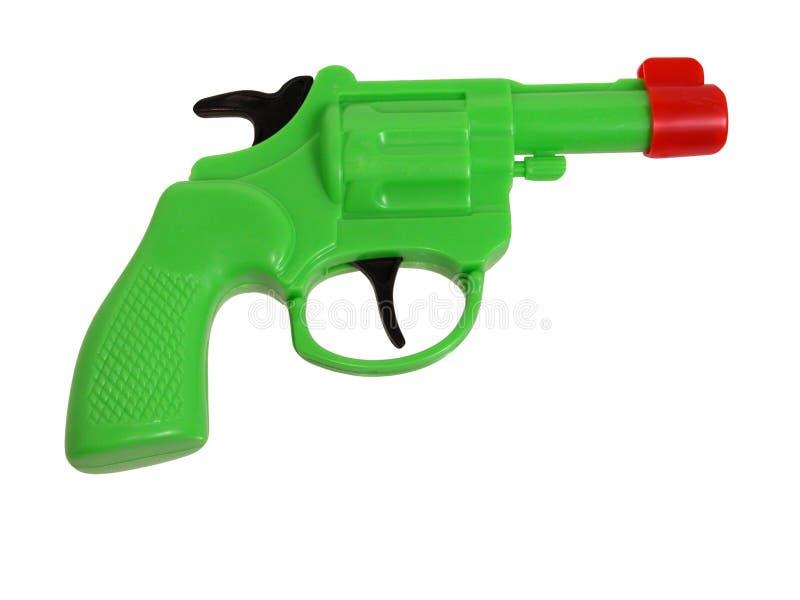 gröna trycksprutaplast-toys arkivbild
