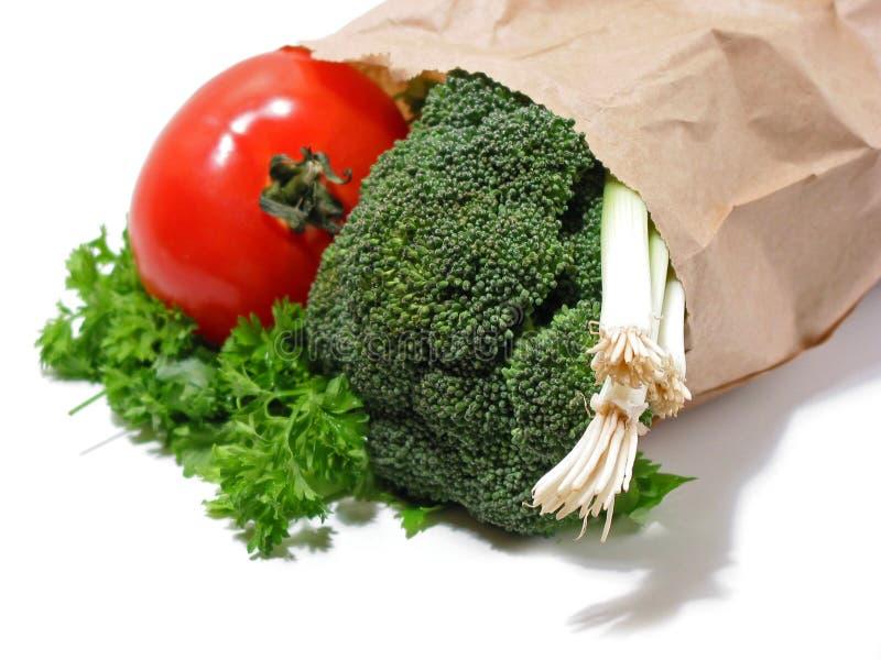 grönsaker för brunt papper för påse arkivbild