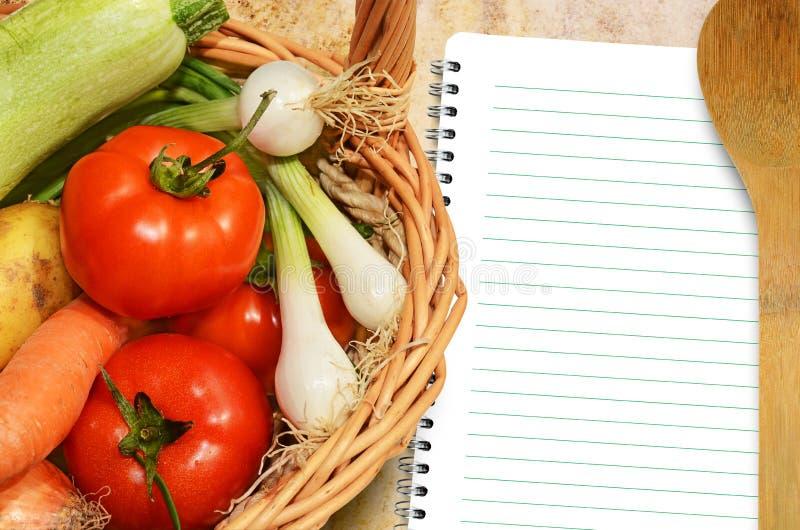 Grönsaker och menybok royaltyfria foton
