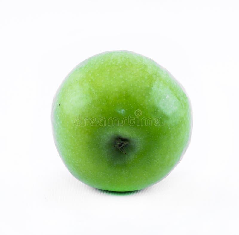Grönt äpple på en vit bakgrund - sidosikt royaltyfri bild