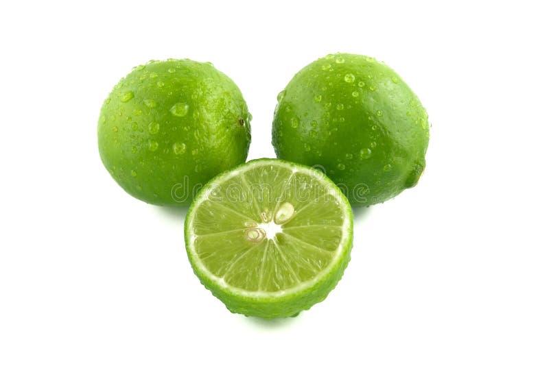 grönt citronvatten för liten droppe arkivbilder