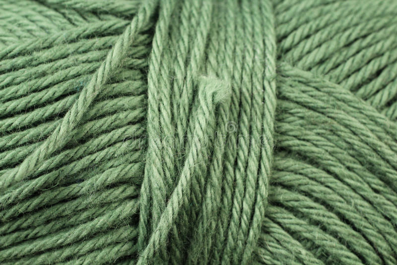 Grönt garntexturslut upp arkivbild