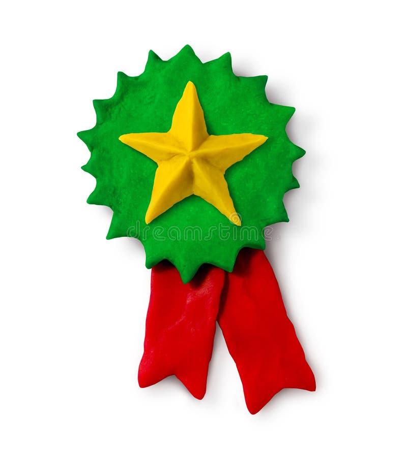 Grönt medaljbaner för plastellina med stjärnan royaltyfria foton