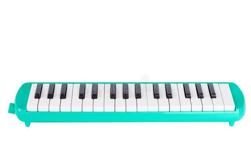 Grönt melodian för musikal som isoleras på vit arkivfoton