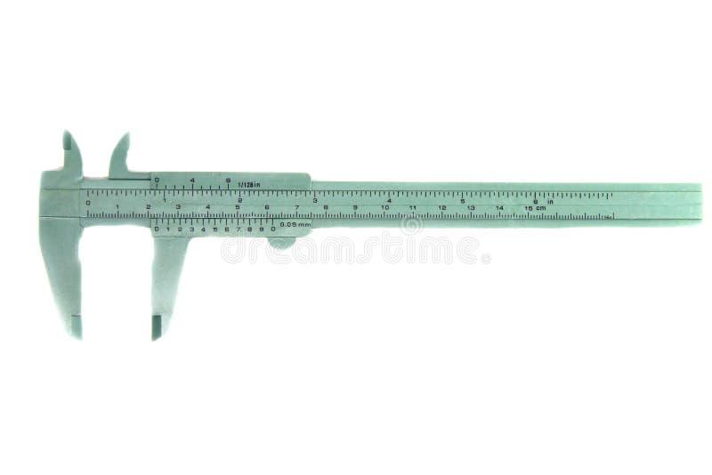 Grönt nonieskalacalipehjälpmedel för mått för mäta instrument som isoleras på vit bakgrund fotografering för bildbyråer