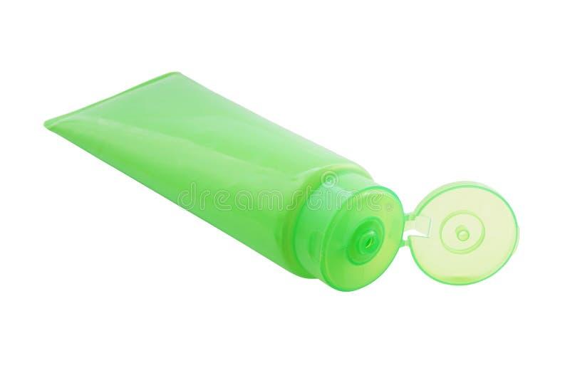 Grönt plast- rör med det öppnade flipöverkantlocket fotografering för bildbyråer