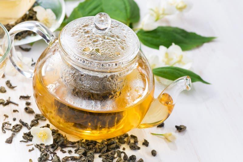 Grönt te med jasmin, closeup royaltyfri foto