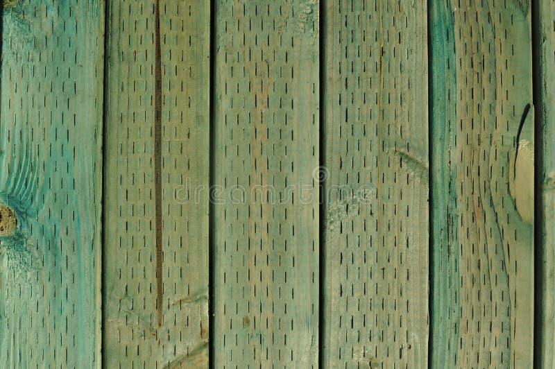 Grün behandelter hölzerner Hintergrund lizenzfreie stockbilder