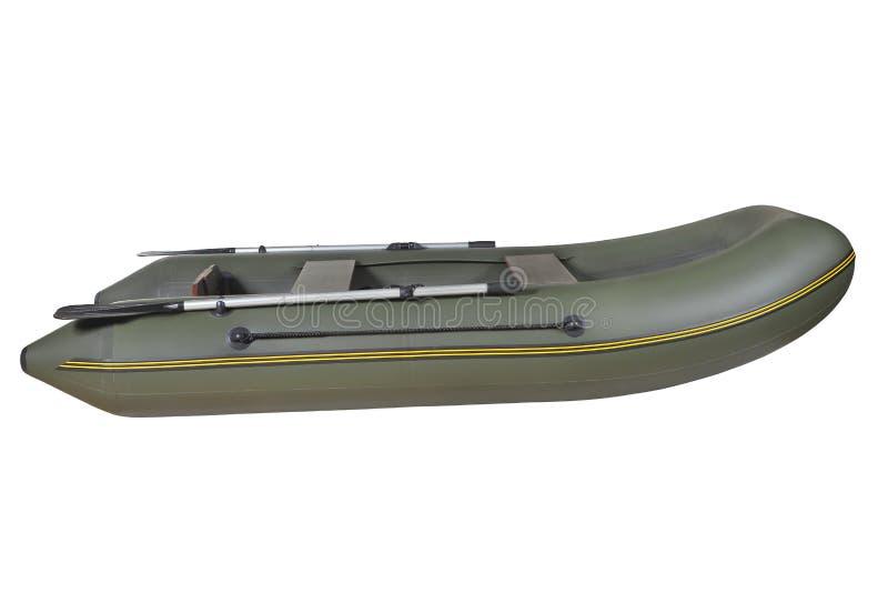 Grün, Gummi, aufblasbares Ruderboot, lokalisiert auf weißem backgro lizenzfreie stockfotos