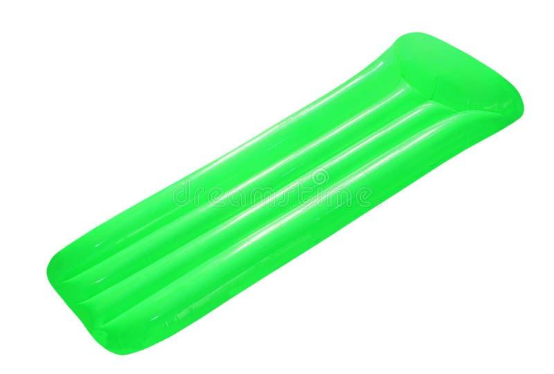 Grüne aufblasbare sich hin- und herbewegende Poolflossmatratze lokalisiert auf Weiß lizenzfreies stockfoto