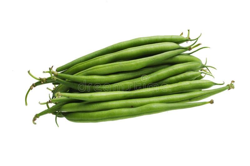 Grüne Bohnen auf weißem Hintergrund lizenzfreies stockfoto