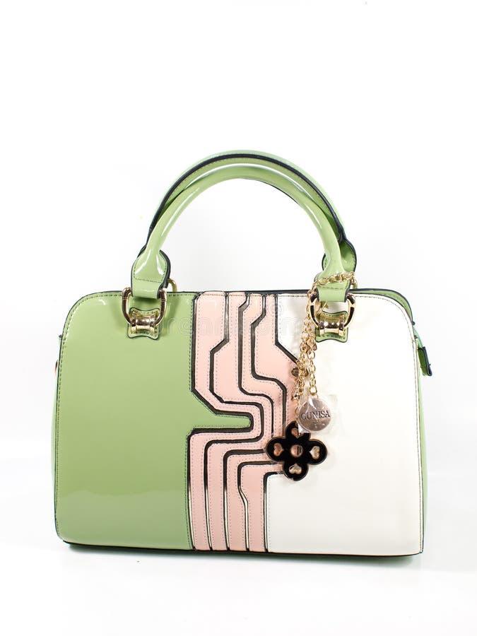 Grüne Damenhandtasche stockbilder