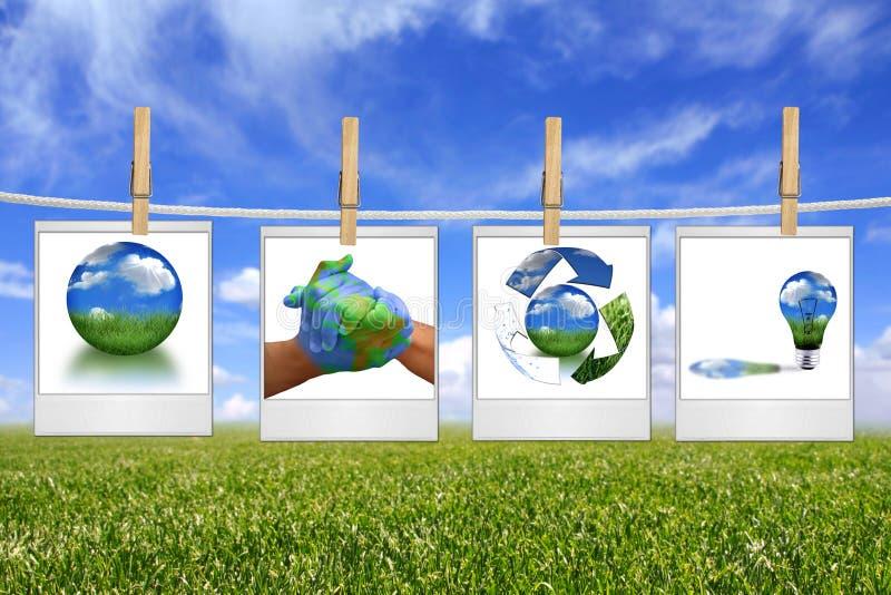 Grüne Energie-Lösungs-Bilder, die an einem Seil hängen lizenzfreies stockbild