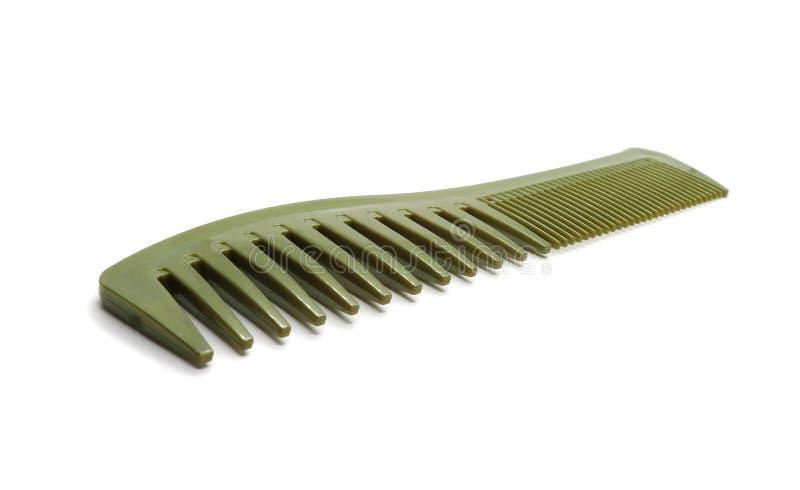 Grüne Farbplastikkamm auf weißem Hintergrund lizenzfreies stockfoto