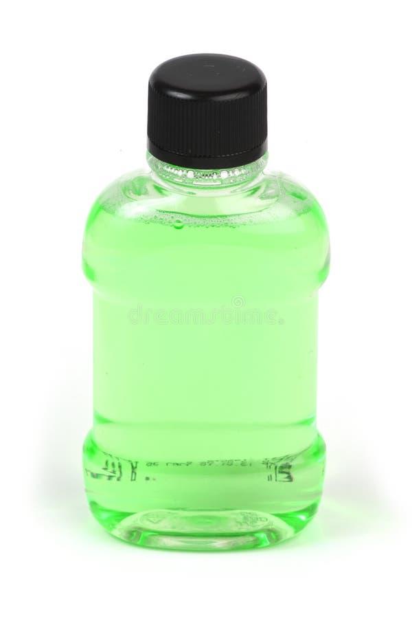Grüne Flasche Flüssigkeit lizenzfreies stockbild