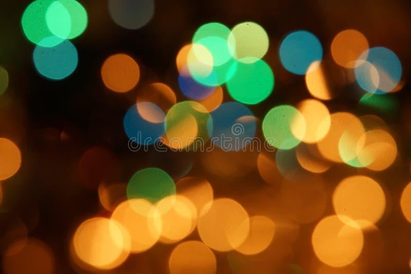 Grüne gelbe blaue Parteistadt der natürlichen Lichter des bokeh Lichterkettehintergrundes hellen stockfotografie