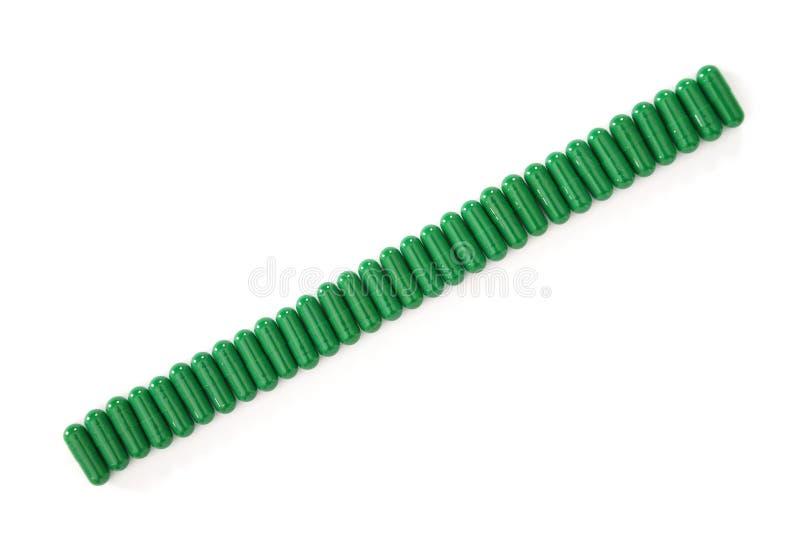 Grüne Kapseln der Gruppe lizenzfreies stockbild