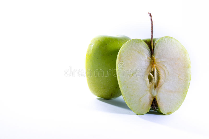 Grüne Oma Smith Apple Cross Section Slice halbiert frische Frucht stockfotos