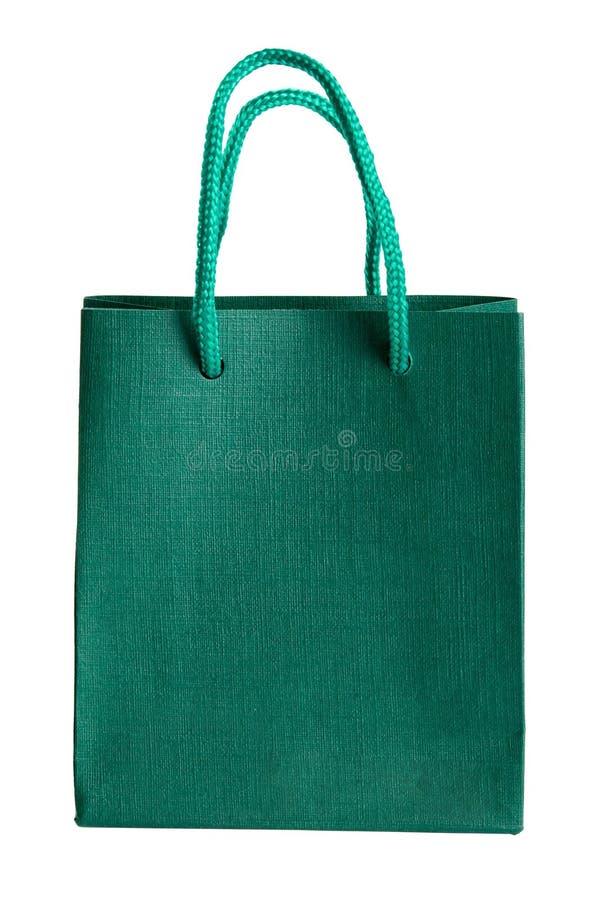 Grüne Papiertüte. stockbilder