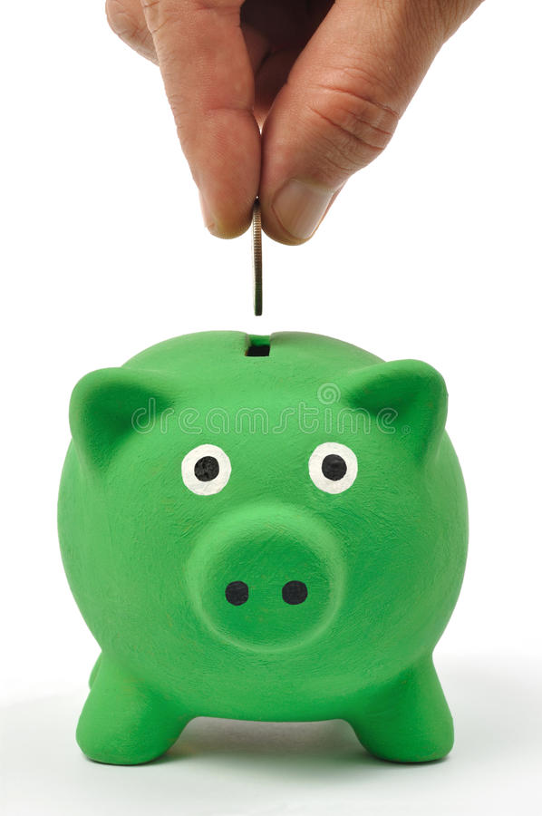 Grüne Piggy Querneigung lizenzfreie stockfotos
