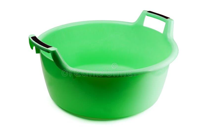 Grüne Plastikreinigungschüssel lizenzfreies stockfoto