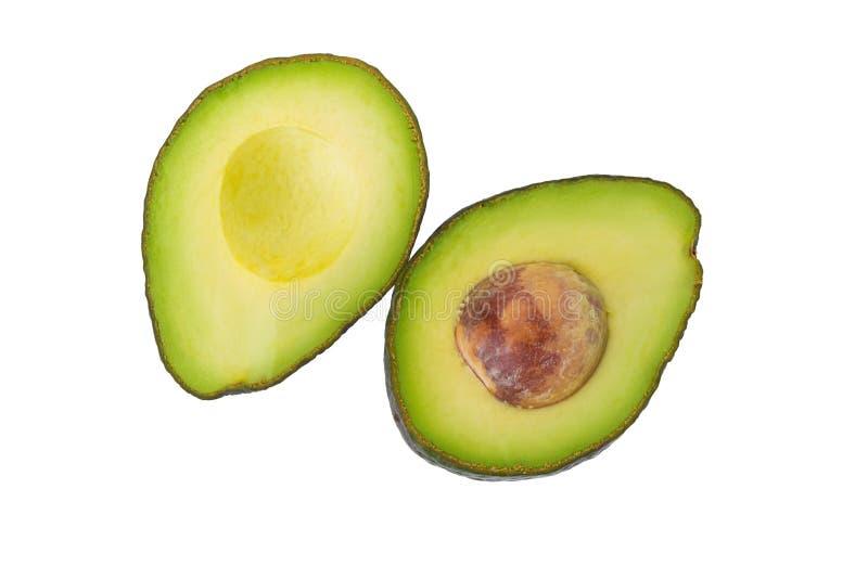 Grüne reife Avocado lokalisiert auf dem weißen Hintergrund stockfotografie