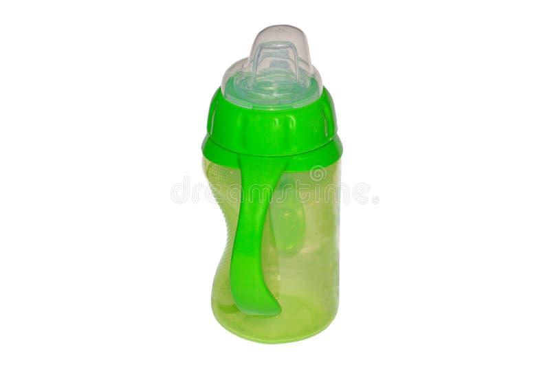 Grüne Säuglingsnahrungsflasche auf weißem Hintergrund lizenzfreies stockfoto