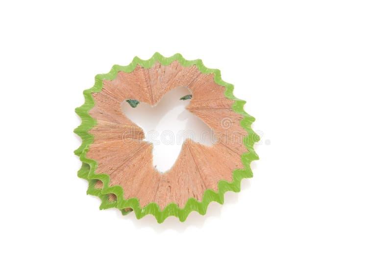 Grüne Schnitzel von den Bleistiften lizenzfreie stockbilder