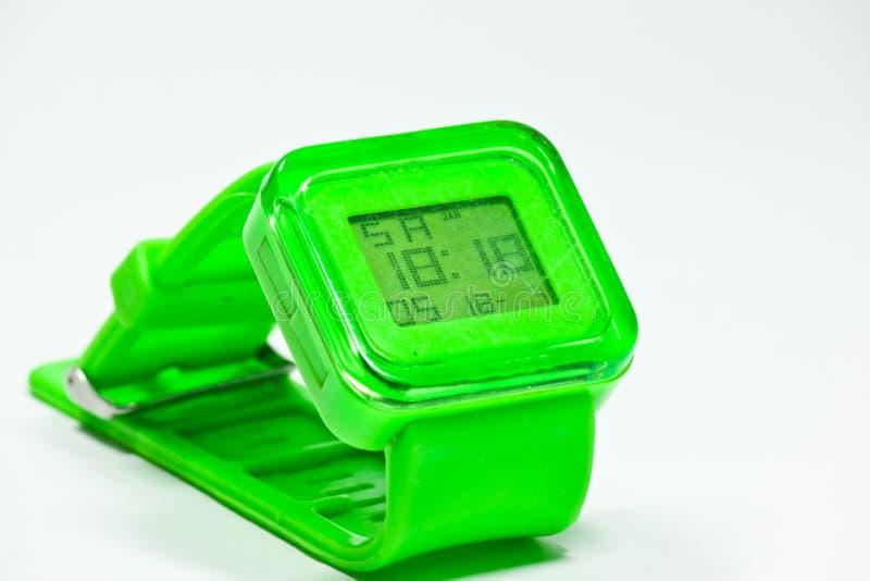 Grüne Uhr lizenzfreie stockbilder