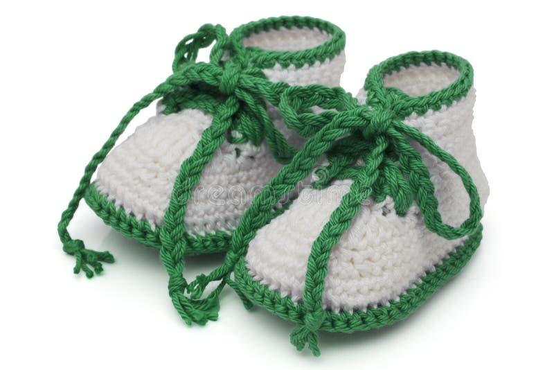 Grüne und weiße handgemachte Babybeuten stockbild