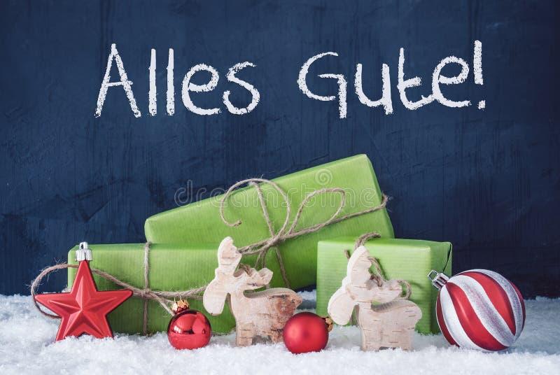 Grüne Weihnachtsgeschenke, Schnee, Alles Gute bedeutet beste Wünsche lizenzfreie stockfotografie