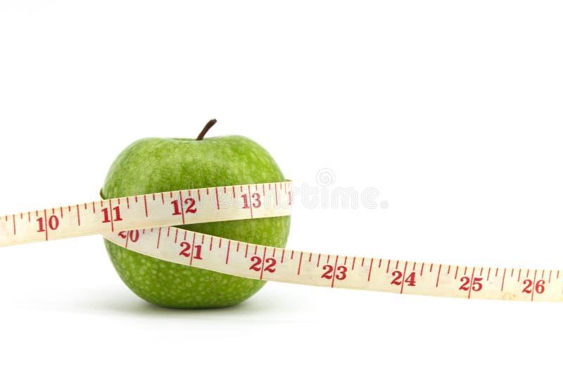 Grüner Apfel mit Band stockbilder