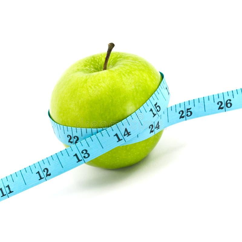 Grüner Apfel mit Band lizenzfreie stockfotos