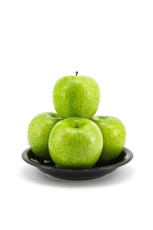 Grüner Apfel mit Platte lizenzfreies stockfoto