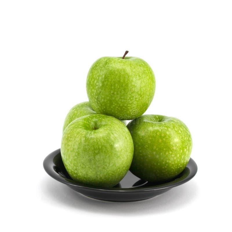 Grüner Apfel mit Platte lizenzfreie stockbilder