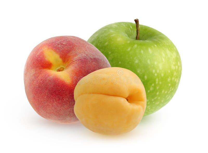 Grüner Apfel, Pfirsich und Aprikose auf einem weißen Hintergrund lizenzfreies stockbild