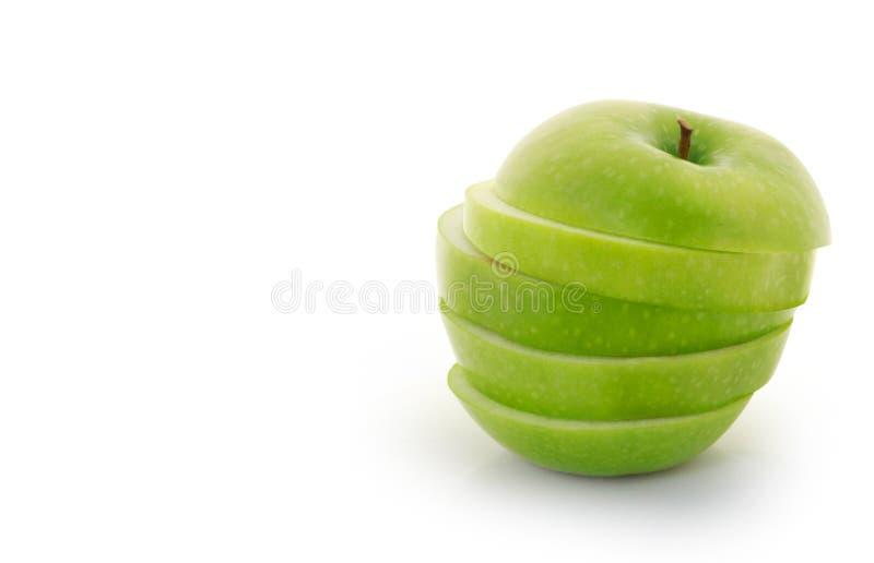 Grüner Apfel in Scheiben geschnitten lizenzfreie stockfotos