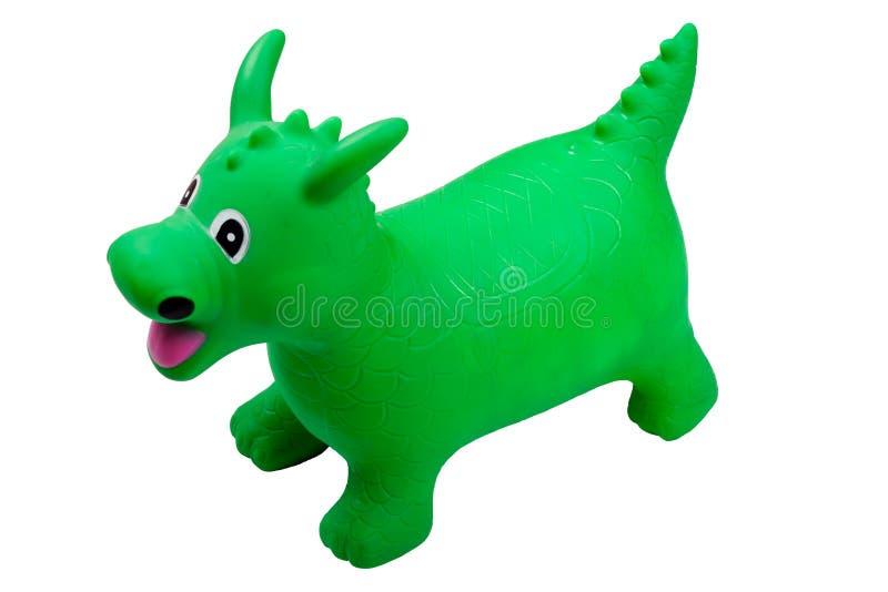 Grüner aufblasbarer Spielzeugdrache stockbild