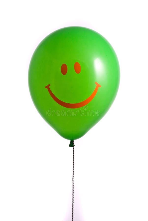 Grüner Ballon mit Lächeln lizenzfreie stockbilder