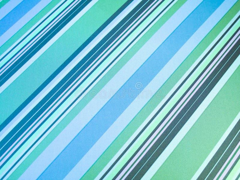 Grüner diagonaler Streifenhintergrund stockfoto
