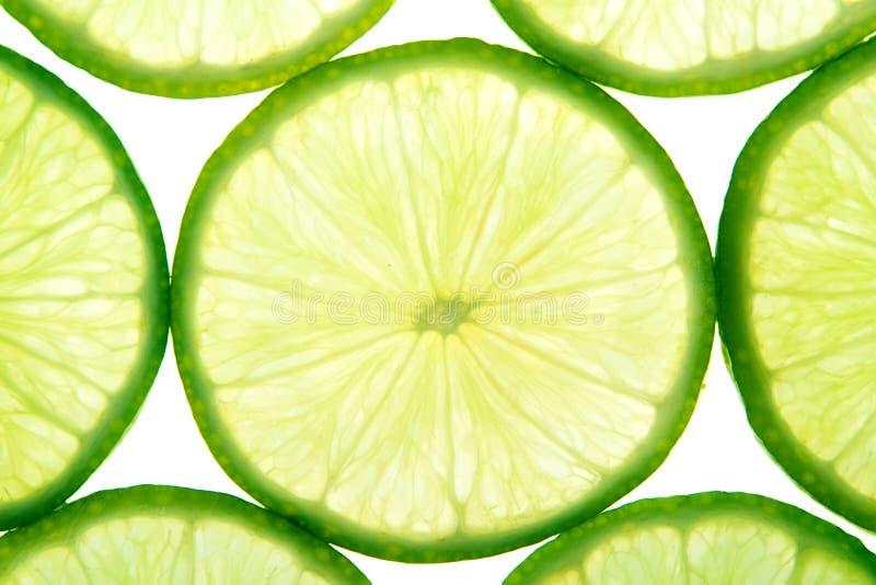 Grüner Kalk schneidet Hintergrund lizenzfreies stockbild