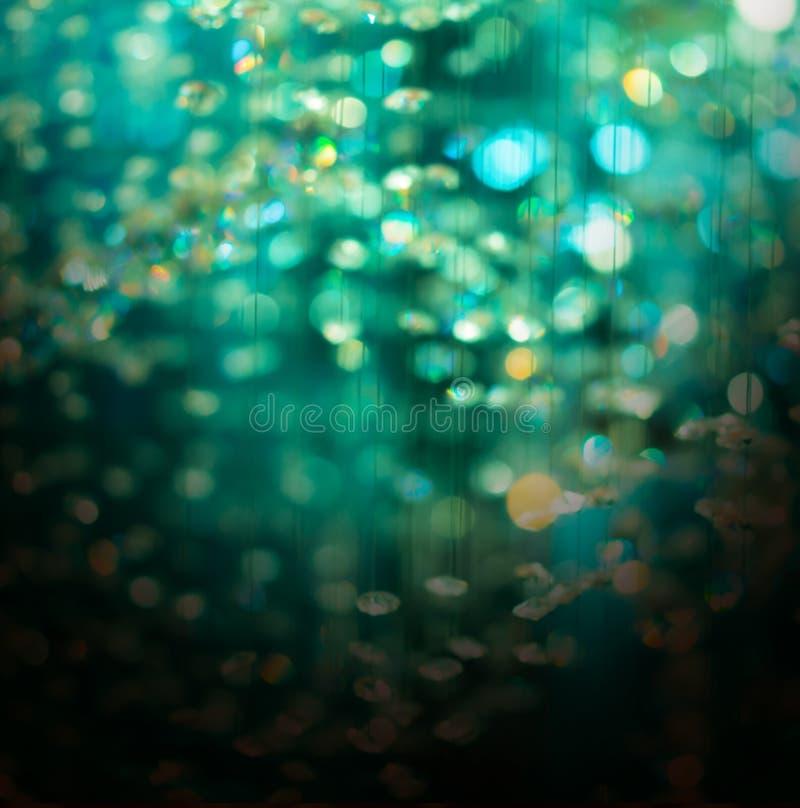 Grüner Kristall-bokeh Weihnachtszusammenfassungshintergrund stockbilder