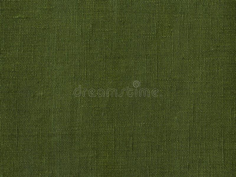 Grüner Leinengewebebeschaffenheitshintergrund stockfotografie
