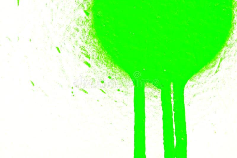 Grüner Sprayfleck auf Weiß stockbilder