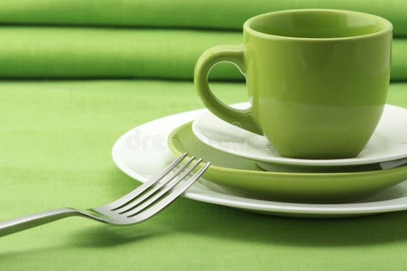 Grüner und weißer Dishware stockfoto