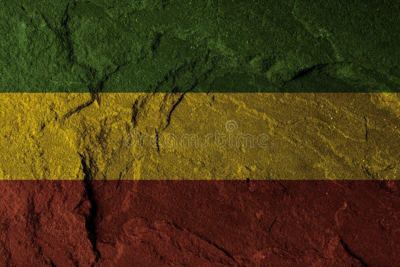 Grünes gelbes Rot auf Steinwand, Reggaehintergrundkonzept stockfotografie