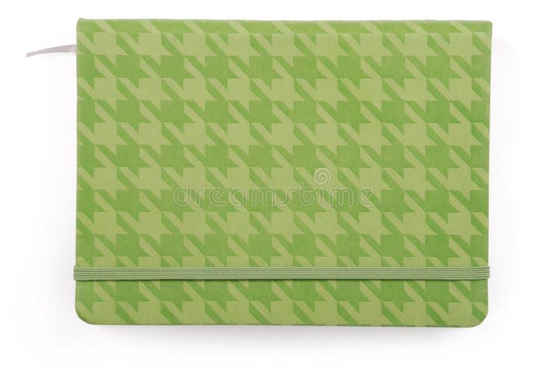 Grünes geschlossenes Notizbuch lizenzfreie stockfotografie