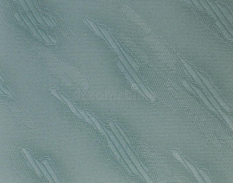 Grünes Gewebe mit Flecken stockfotografie
